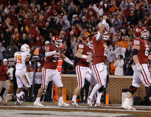 Oklahoma&#039;s Blake Bell (10) celebrates after scoring a touchdown at the end of regulation during the Bedlam college football game between the University of Oklahoma Sooners (OU) and the Oklahoma State University Cowboys (OSU) at Gaylord Family-Oklahoma Memorial Stadium in Norman, Okla., Saturday, Nov. 24, 2012. Oklahoma won 51-48. Photo by Bryan Terry, The Oklahoman