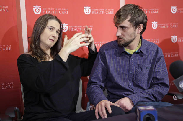Elisabeth Malloy, avalanche survivor, and skiing partner and initial rescuer Adam Morrey discuss their ordeal during a news conference at the University of Utah Health Care's Burn Center Wednesday, Jan. 16, 2013, in Salt Lake City. Malloy suffered frost bite in her toes and fingers, but emerged otherwise unscathed from Saturday�s near-death encounter in the mountains east of Salt Lake City. She survived thanks to her boyfriend, Adam Morrey, avalanche rescue beacons, a skier that wandered by and avalanche rescue teams.  (AP Photo/Rick Bowmer)