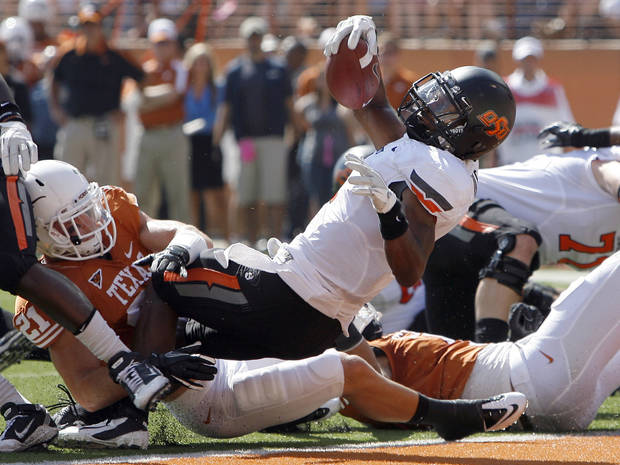 Oklahoma State's Joseph Randle (1) scores a touchdown during first half of a college football game between the Oklahoma State University Cowboys (OSU) and the University of Texas Longhorns (UT) at Darrell K Royal-Texas Memorial Stadium in Austin, Texas, Saturday, Oct. 15, 2011. Photo by Sarah Phipps, The Oklahoman