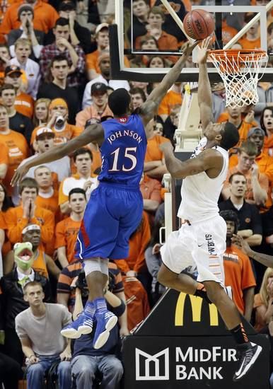 Oklahoma State 's Marcus Smart (33) blocks a shot by Kansas' Elijah Johnson (15) during the college basketball game between the Oklahoma State University Cowboys (OSU) and the University of Kanas Jayhawks (KU) at Gallagher-Iba Arena on Wednesday, Feb. 20, 2013, in Stillwater, Okla. Photo by Chris Landsberger, The Oklahoman