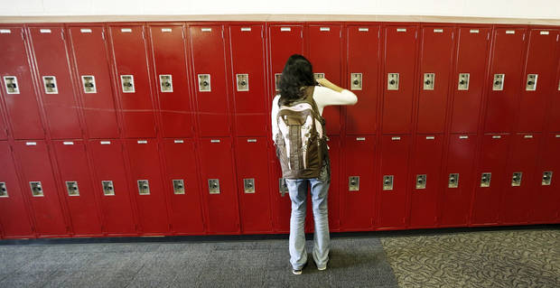An unidentified student opens her locker at Yukon Middle School, Thursday  August 15, 2013. Photo By Steve Gooch, The Oklahoman