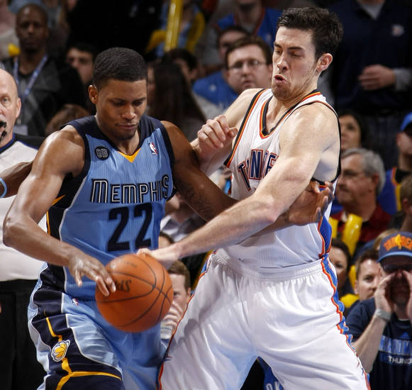 Oklahoma City's Nick Collison (4) fight for the ball with Memphis' Rudy Gay (22)during the NBA game between the Oklahoma City Thunder and the Memphis Grizzlies at Chesapeake Energy Arena in Oklahoma CIty, Friday, Feb. 3, 2012. Photo by Bryan Terry, The Oklahoman