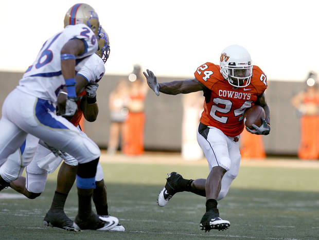 Oklahoma State running back Kendall Hunter (24) gets by the Tulsa defense during the college football game between the University of Tulsa (TU) and Oklahoma State University (OSU) at Boone Pickens Stadium in Stillwater, Oklahoma, Saturday, September 18, 2010. Photo by Sarah Phipps, The Oklahoman