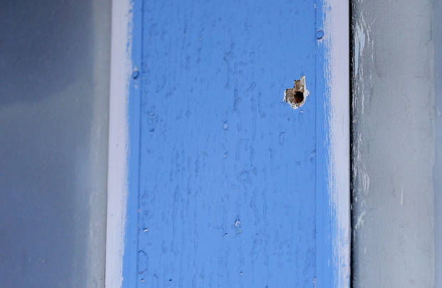A bullet hole from a drive-by shooting is pictured Friday at the Taghavi home in southwest Oklahoma City. Photo by Sarah Phipps, The Oklahoman <strong>SARAH PHIPPS</strong>