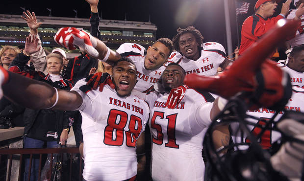 Texas Tech celebrates the 41-38 win over Oklahoma during the college football game between the University of Oklahoma Sooners (OU) and Texas Tech University Red Raiders (TTU) at the Gaylord Family-Oklahoma Memorial Stadium on Sunday, Oct. 23, 2011. in Norman, Okla. Photo by Chris Landsberger, The Oklahoman