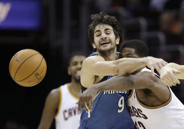 Minnesota Timberwolves' Ricky Rubio, left, and Cleveland Cavaliers' Tristan Thompson battle for a loose ball in the third quarter of an NBA basketball game Monday, Feb. 11, 2013, in Cleveland. The Timberwolves won 100-92. (AP Photo/Tony Dejak)