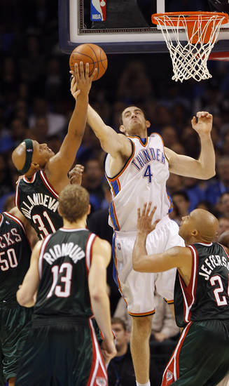 Nick Collison of the Thunder defends on the Bucks' Charlie Villanueva (31) during the opening NBA basketball game between the Oklahoma City Thunder and the Milwaukee Bucks at the Ford Center in Oklahoma City, Wednesday, October 29, 2008.  BY BRYAN TERRY, THE OKLAHOMAN