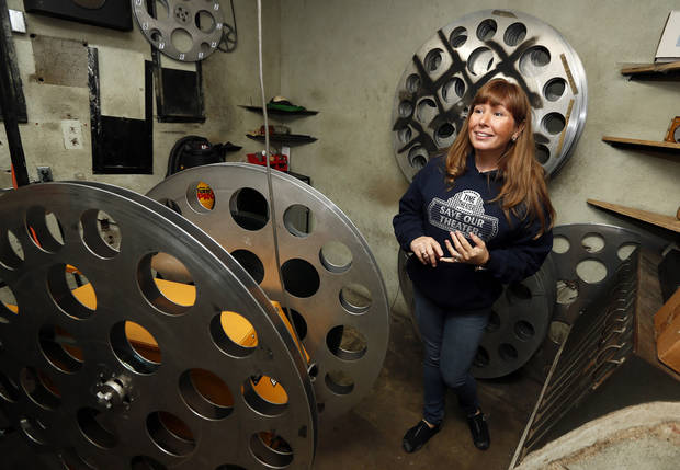 Mitzi Woodson, head of the �Save Our Theater� project in Stigler, talks about the theater in the projection room at the Time Theater.