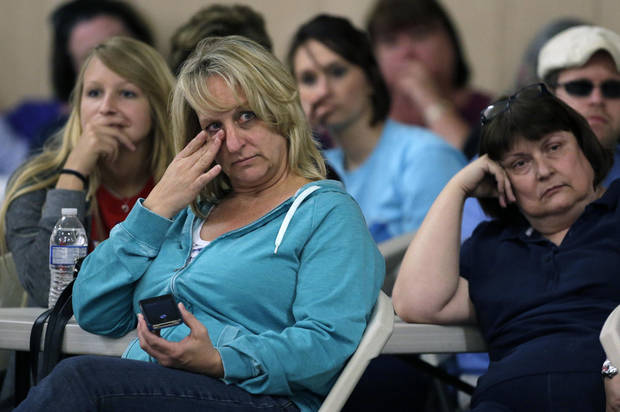 West, Texas residents listen during a town hall meeting Saturday, April 20, 2013, three days after an explosion at a fertilizer plant in West, Texas. The massive explosion at the West Fertilizer Co. Wednesday night killed 14 people and injured more than 160. (AP Photo/Charlie Riedel)