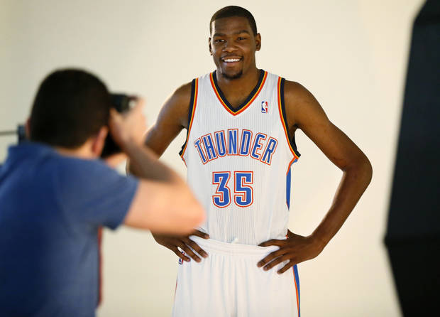 Kevin Durant has his photo taken during media day for the Oklahoma City Thunder NBA basketball team at the Thunder Events Center in Oklahoma City, Monday, Oct. 1, 2012.  Photo by Nate Billings, The Oklahoman