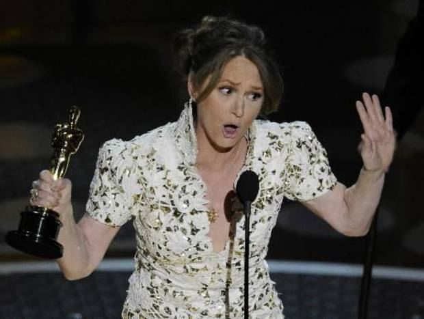 "Melissa Leo, a former Tulsa resident, accepts the best supporting actress Oscar for her turn in ""The Fighter"" Sunday night during the 83rd Annual Academy Awards. (Associated Press photos)"