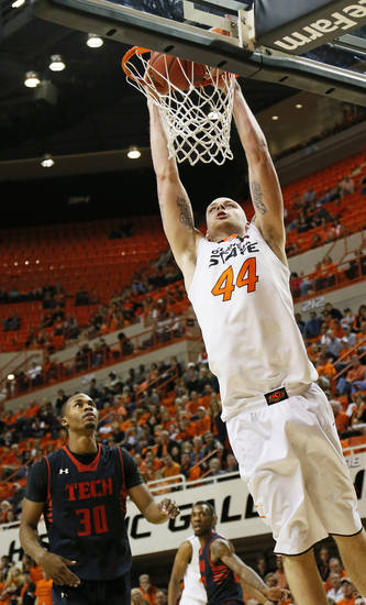 Oklahoma State's Philip Jurick (44) dunks the ball in front of Texas Tech's Jaye Crockett (30) during a men's college basketball game between Oklahoma State University and Texas Tech at Gallagher-Iba Arena in Stillwater, Okla., Saturday, Jan. 19, 2013. OSU won, 79-45. Photo by Nate Billings, The Oklahoman