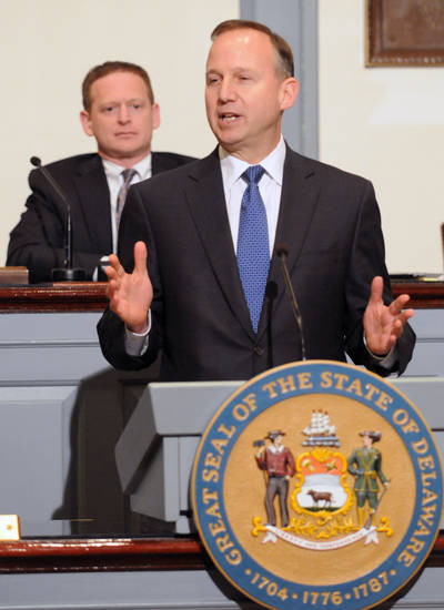 Delaware Gov. Jack Markell delivering his state of the state speech before a joint session of the General Assembly Thursday, Jan. 17, 2013 in Dover, Del. In background is Lt. Gov. Matt Denn. (AP Photo/The News Journal, Gary Emeigh)