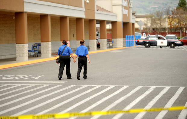 Unidentified women leave a San Jose, Calif., Walmart after a motorist drove through a store entrance and began assaulting shoppers on Sunday, March 31, 2013. Four people sustained injuries during the attack according to a police spokesman. (AP Photo/Noah Berger)