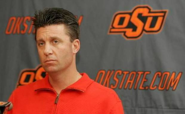Oklahoma State University (OSU) college football head coach Mike Gundy talks about the upcoming Holiday Bowl football game with the Oregon Ducks during a media luncheon in Stillwater , Okla. December 17, 2008. BY STEVE GOOCH