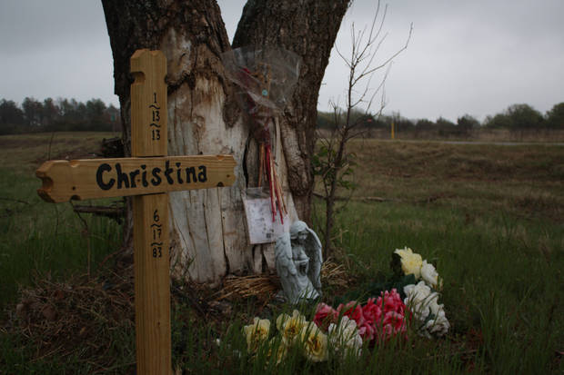 A roadside memorial pays tribute to Christina Lynn Hill, of Edmond, who died Jan. 13 in a wreck on State Highway 51 in Payne County. Photo by Adam Kemp, The Oklahoman