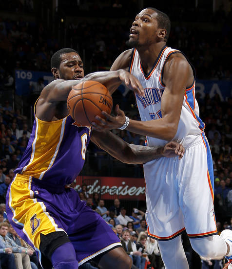 Oklahoma City's Kevin Durant (35) is fouled by Earl Clark (6) during an NBA basketball game between the Oklahoma City Thunder and the Los Angeles Lakers at Chesapeake Energy Arena in Oklahoma City, Tuesday, March. 5, 2013. Photo by Bryan Terry, The Oklahoman