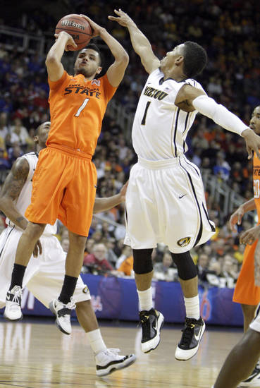 Oklahoma's Cezar Guerrero (1) shoots as Missouri's Phil Pressey (1) defends during the Big 12 tournament men's basketball game between the Oklahoma State Cowboys and Missouri Tigers the Sprint Center, Thursday, March 8, 2012.  Photo by Sarah Phipps, The Oklahoman