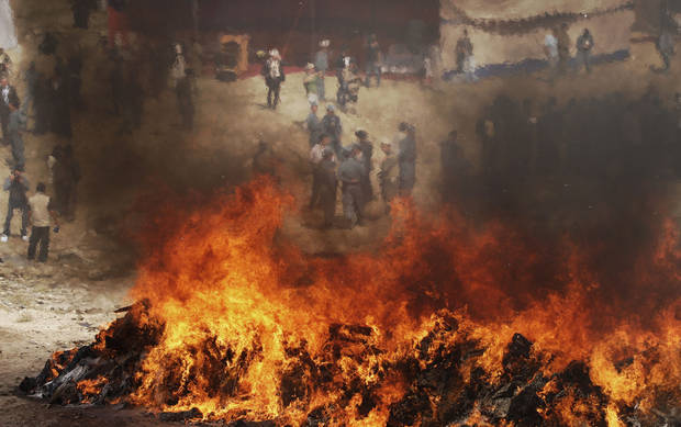 Afghan counternarcotic police (CNPA) burn 25 tons of drugs and drug-making gear in the outskirts of Kabul, Afghanistan, Sunday, Oct. 14, 2012. The 25 tons of drugs and paraphernalia where confiscated over the past nine months in the Kabul area. (AP Photo/Ahmad Jamshid)