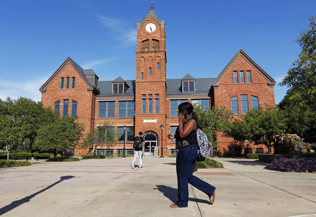 People walk past the west side of Old North on the campus of the University of Central Oklahoma, in Edmond, Okla., Monday, Aug. 20, 2012. Photo by Nate Billings, The Oklahoman