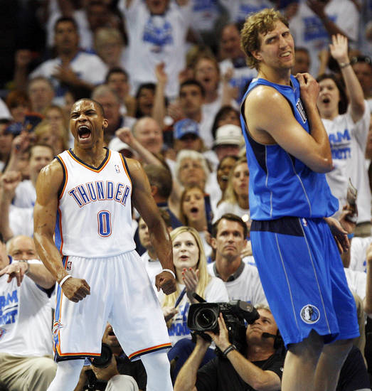 Oklahoma City's Russell Westbrook (0) reacts next to Dallas' Dirk Nowitzki (41) after Westbrook scored a basket and was fouled during Game 2 of the first round in the NBA basketball  playoffs between the Oklahoma City Thunder and the Dallas Mavericks at Chesapeake Energy Arena in Oklahoma City, Monday, April 30, 2012. Photo by Nate Billings, The Oklahoman
