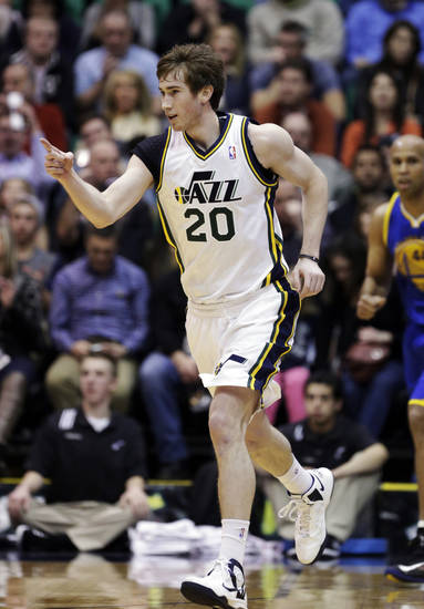 Utah Jazz's Gordon Hayward (20) points down court after scoring a 3-point basket in the second quarter during an NBA basketball game against the Golden State Warriors Tuesday, Feb. 19, 2013, in Salt Lake City. (AP Photo/Rick Bowmer)