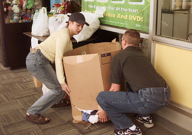 MAY 3, 1999 TORNADO: Tornado victims relief donations: 2nd year OU law student from Tulsa, Heather Threadgill drops off a box of clothes at hastings with help from employee Jeremy Bardin.