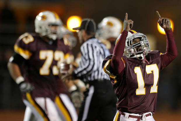 Clinton's Donivien Brown celebrates a fumble recovery during the high school playoff game between Ada and Clinton at Putnam City High School in Oklahoma City, Friday, Nov. 23, 2012. Photo by Sarah Phipps, The Oklahoman