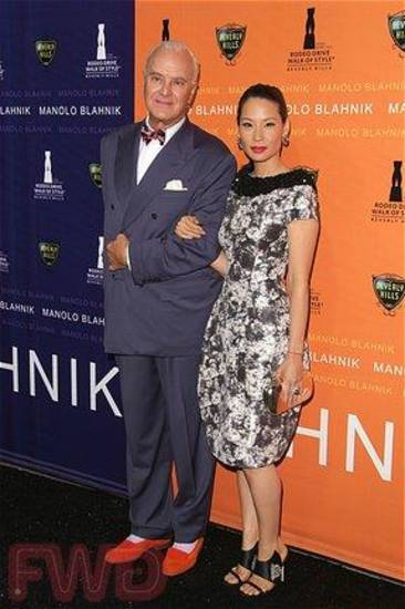 Shoe designer Manolo Blahnik with actress Lucy Liu