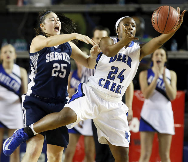 Deer Creek's Dakota Vann (24) grabs the ball in front of Shawnee's Micaela Yu (25) during the Class 5A girls championship high school basketball game in the state tournament at the Mabee Center in Tulsa, Okla., Saturday, March 9, 2013. Photo by Nate Billings, The Oklahoman