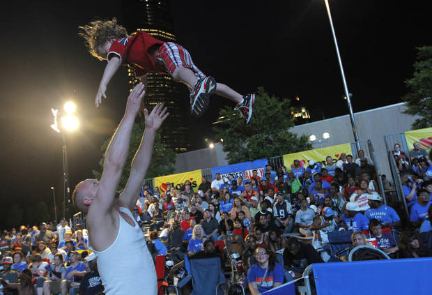 James Crane, of Oklahoma City, tosses his son, James III, at Love's Thunder Alley, Monday, April 30, 2012.  Photo by Garett Fisbeck, For The Oklahoman