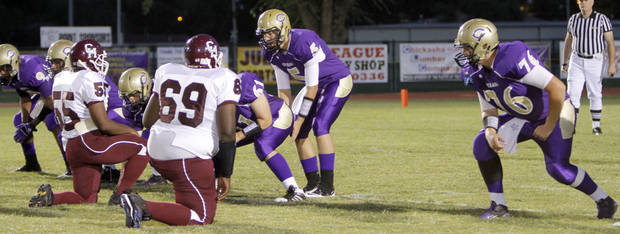 Chickasha lines up without a left guard on the first play of the football game between Chickasha and Capitol Hill at Chickasha High School, Friday, Oct. 1, 2010. It was the first home game since the death of player Kody Turner. Photo by Sarah Phipps, The Oklahoman