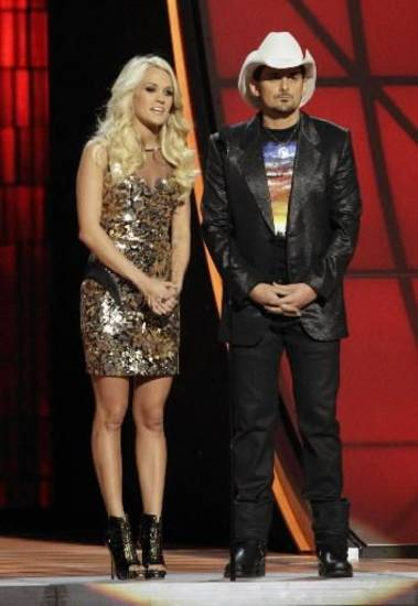 Checotah native Carrie Underwood and Brad Paisley appear onstage during the 2012 CMA Awards. (AP file)
