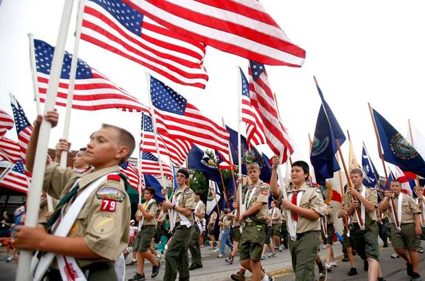 Boy Scouts march with American flags during the LibertyFest Parade, Saturday, July 3, 2010, in downtown Edmond, Okla. Photo by Sarah Phipps, The Oklahoman