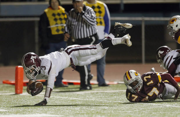 Ada&#039;s Easton Pingleton dives for a touchdown in front of Donivien Brown during the high school playoff game between Ada and Clinton at Putnam City High School in Oklahoma City, Friday, Nov. 23, 2012. Photo by Sarah Phipps, The Oklahoman