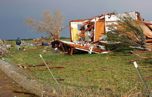 A destroyed home is seen on SH 74, east of Cashion, after a tornado came through the area Tuesday afternoon. Residents escaped before the tornado hit.