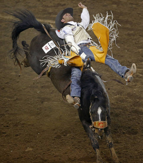 Casey Colletti of Pueblo, Colo., competes in bareback riding during the National Circuit Finals Rodeo at the State Fair Arena in Oklahoma City, Thursday, April 4, 2013. Photo by Bryan Terry, The Oklahoman
