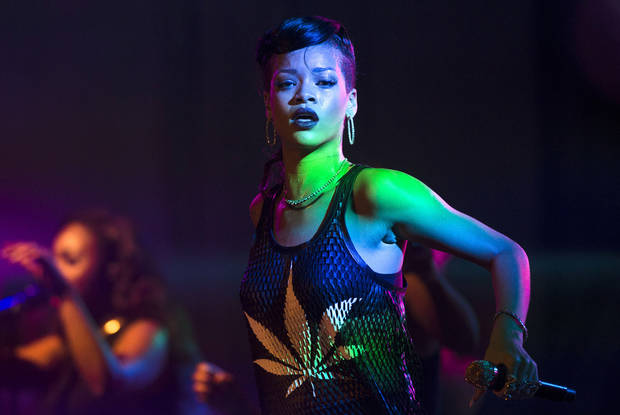 FILE - In this Monday, Nov. 19, 2012 file photo Barbadian singer Rihanna performs during the fifth stop of her 777 worldwide tour at the E-Werk club in Berlin. A debut design showcase by singer Rihanna and Tom Ford&#039;s first proper catwalk show in London Fashion Week are headlining the five-day style extravaganza that begins Friday Feb. 15, 2013. (AP Photo/Markus Schreiber, File)