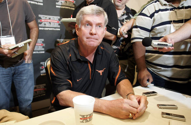 Texas head football coach Mack Brown talks with reporters at Big 12 media day in Irving, Texas, on Wednesday, July 28, 2010.  (AP Photo/Mike Fuentes) ORG XMIT: TXMF101