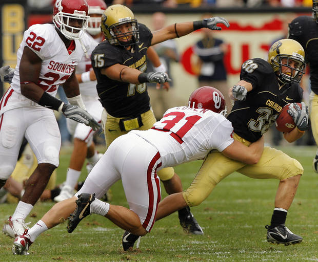 Colorado's Chase McBride (38) is stopped by Oklahoma's Michael Cohen (31) during McBride's 25 yard kick return that led to Colorado's game winning field goal during the second half of the college football game between the University of Oklahoma Sooners (OU) and the University of Colorado Buffaloes (CU) at Folsom Field on Saturday, Sept. 28, 2007, in Boulder, Co. 