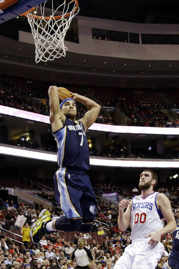Memphis Grizzlies' Jerryd Bayless (7) goes up for a dunk past Philadelphia 76ers' Spencer Hawes during the first half of an NBA basketball game, Monday, Jan. 28, 2013, in Philadelphia. (AP Photo/Matt Slocum)