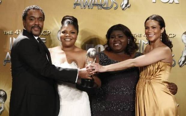 "The cast of ""Precious"" at the NAACP Image Awards.  (from left) Director Lee Daniels, Mo'Nique, Gabourey Sidibe and Paula Patton. (AP Photo/Matt Sayles)"