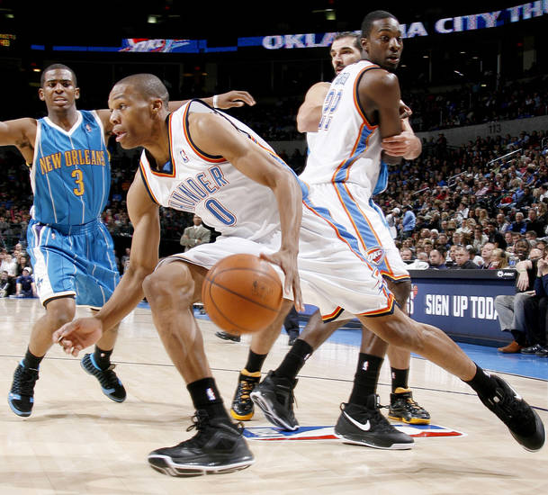 Oklahoma City&#039;s Russell Westbrook drives past teammate Jeff Green as Chris Paul and Peja Stojakovic of New Orleans watch during NBA basketball game between the Oklahoma City Thunder and the New Orleans Hornets at the Ford Center in Oklahoma City on Friday, Nov. 21, 2008.  BY BRYAN TERRY, THE OKLAHOMAN