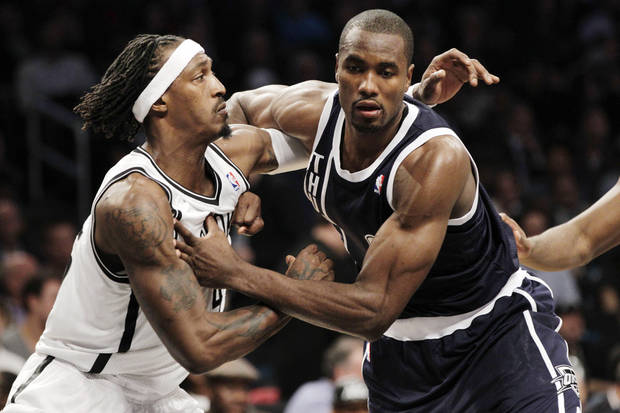 Brooklyn Nets forward Gerald Wallace (45) jostles with Oklahoma City Thunder center Kendrick Perkins (5) on a rebound in the second half of their NBA basketball game at Barclays Center, Tuesday, Dec. 4, 2012, in New York. The Thunder won 117-111. (AP Photo/Kathy Willens)