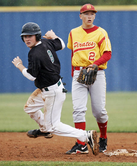 Tushka's Jody Moreland (8) crosses second base in front of Dale's Chase Byndas (2) during a Class 2A state high school baseball championship semifinal game between Dale and Tushka at Palmer Field inside Dolese Park in Oklahoma City, Friday, May 11, 2012. Photo by Nate Billings, The Oklahoman