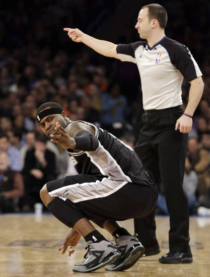 San Antonio Spurs forward Stephen Jackson (3) gestures toward the sideline after spraining his right ankle when he took a shot then fell back into a waitress working the sideline in front of Mayor Michael Bloomberg in the first half of an NBA basketball game against the New York Knicks at Madison Square Garden in New York, Thursday, Jan. 3, 2013. The Knicks won 100-83. (AP Photo/Kathy Willens)