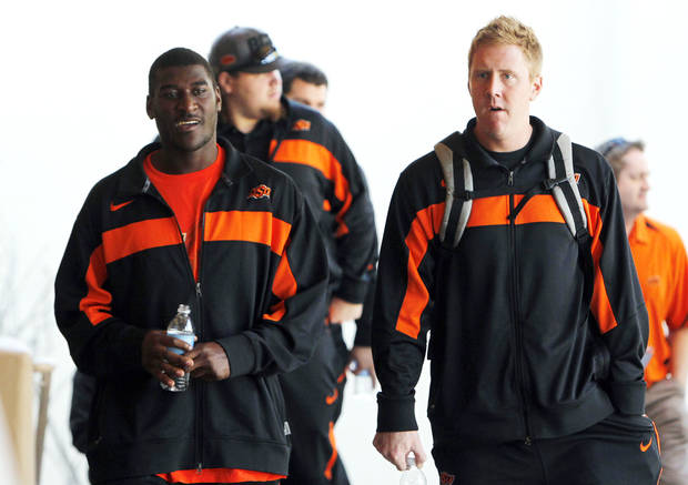   Oklahoma State&#039;s Justin Blackmon, left, and Brandon Weeden walk together as they arrive prior to a Fiesta Bowl NCAA college football game news conference Thursday, Dec. 29, 2011, in Paradise Valley, Ariz. Oklahoma State will face Stanford in the 41st annual Fiesta Bowl on Jan. 2, 2012. (AP Photo/Ross D. Franklin)  