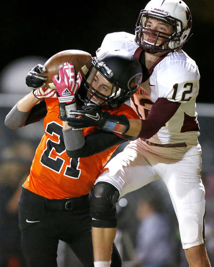 Cashion's Nate Lee, at right, catches a touchdown pass over Crescent's Tristan Lacey during a high school football game between Cashion and Crescent in Crescent, Okla., Thursday, Oct. 18, 2012.  Photo by Bryan Terry, The Oklahoman