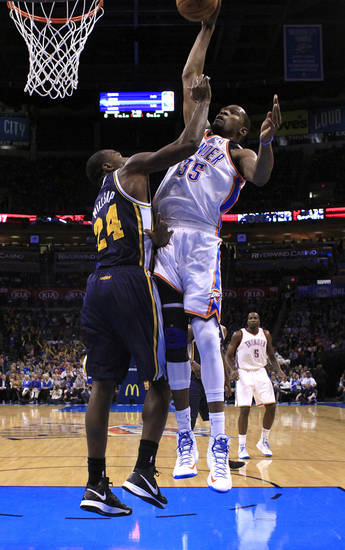 Oklahoma City's Kevin Durant (35) dunks over Utah's Paul Millsap (24) during the NBA game between the Oklahoma City and the Utah Jazz and the Chesapeake Energy Arena, Friday,Nov. 30, 2012. Photo by Sarah Phipps, The Oklahoman