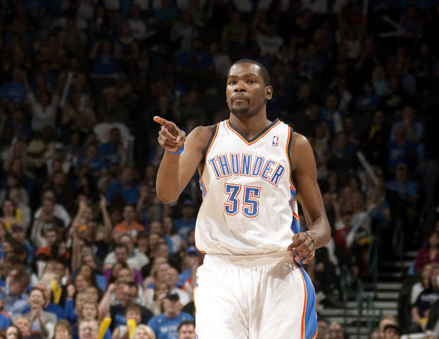 CELEBRATION: Oklahoma City's Kevin Durant (35) celebrates during the NBA basketball game between the Oklahoma City Thunder and the Toronto Raptors at Chesapeake Energy Arena in Oklahoma City, Sunday, April 8, 2012. Photo by Sarah Phipps, The Oklahoman.